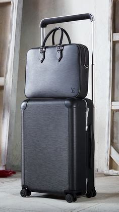 Louis Vuitton Horizon 55 Rolling Luggage and Dandy MM Business Bag in Black Epi Leather.