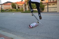 My Bro ollying over his old skateboard deck