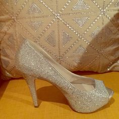 Size 7.5 Silver Sparkle Heels from Aldo Worn only once, these heels are perfect for a night out! ALDO Shoes Heels