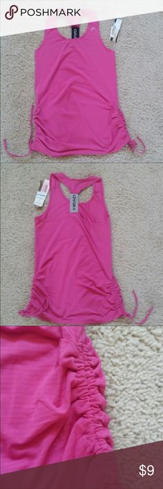 NWT Pink high performance tank top in pink size XS Brand new with tags a high performance tank top size by Head, size XS. The fabric is stretchy and moisture wicking. Great pink color and adjustable drawstrings on both sides. Head Tops Tank Tops