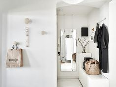 We can't all live in Stockholm, but we can steal a little Scandinavian thunder for our own homes. Look to this small apartment (currently for sale) for tons of great remodeling ideas worth remembering. It's chock full of ways to own stuff without all of it crowding you out and feeling claustrophobic.