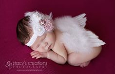 Baby Angel wings, you choose color either white or pink angel wings. Ready to ship. Great newborn photography prop. $15.99, via Etsy.