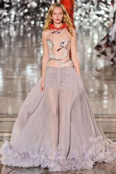 Giles Deacon Spring 2012 collection. Swan (Bjork inspired?) sheer top with lavendar-grey flowing skirt with feathers. Pop of red feathers at collar completes this look. Kinda diggin' this.
