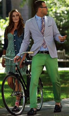 Light grey sport coat, light blue shirt with white candy stripes, plaid tie, green pants
