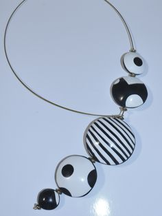 black and white hollow bead necklace with front closure.