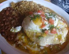 New Mexico style stacked enchiladas.  Yes those are fried eggs on top!