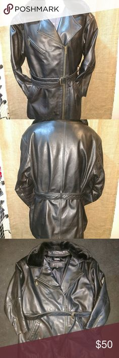 Wilson's ladies large lined leather jacket This is an almost like new, Wilson's large ladies lined leather coat, nice and long with belt looks like it's hardly ever been worn, comes with free bottle of leather conditioner and coat cleaner. Wilsons Leather Jackets & Coats
