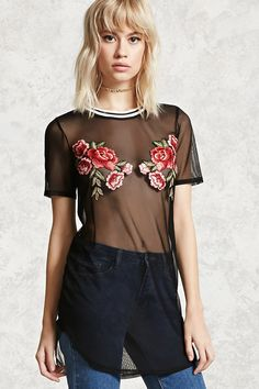 A sheer mesh knit top featuring an embroidered floral applique on the chest, a striped crew neckline, short sleeves, and a longline silhouette.