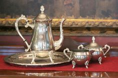 This is a wonderful matching tea set.  The teapot and the cream & sugar are made by Leonard.  I've paired this set with an Oneida serving tray.