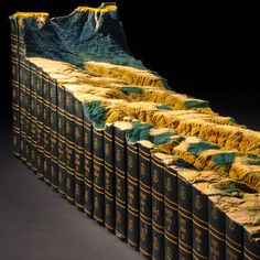 In one of his most ambitious book sculptures to date artist Guy Laramée (previously here and here) created an homage to the printed Encyclopedia Britannica by transforming a 24-volume set into a sloping mountainous landscape. Titled Adieu, Laramée says the work was inspired in part b