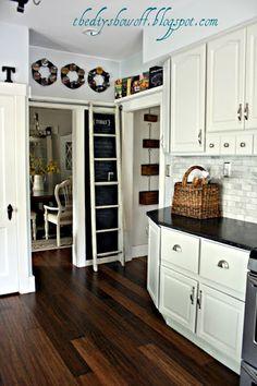 GORGEOUS combo of white cabinets, dark floors and subway tile backsplash