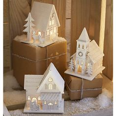These assorted tabletop snowy village buildings are an enchanting way to illuminate your tabletop this Christmas.