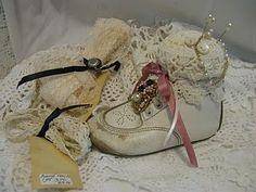 Vintage baby shoe pincushions.