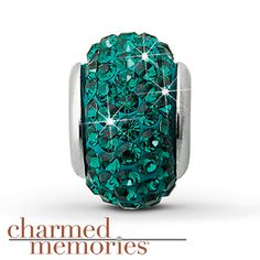 Charmed Memories Swarovski Elements Charm Sterling Silver Stock number: 811365408 This Charmed Memories® charm, featuring emerald green SWAROVSKI ELEMENTS, is crafted in sterling silver.