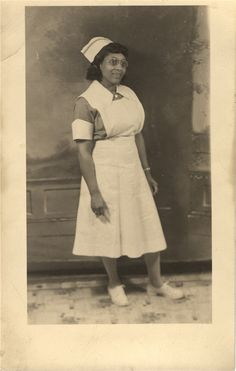 A nurse stands for portrait in nursing uniform, United States, 1940s.