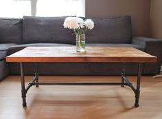 Wood Coffee table with steel pipe legs made of reclaimed wood, Standard 1.65 top, 18 tall x 48 L x 20 w. $395.00, via Etsy.