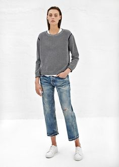 Long-sleeved sweater in cotton with navy and white pattern throughout, ribbed round neckline, cuffs and bottom hem. Solid navy detailing at armholes, sides and inner arm. Hand wash cold. Lay flat to dry.