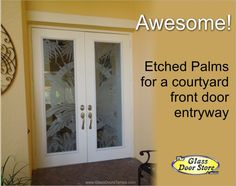 etched palm tree leafs on glass doors. front entryway double doors