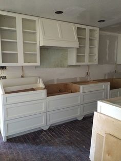 Lots of lower cabinet drawers, simple shaker styling & range hood