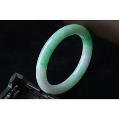 Never go anywhere without my Jade bangle!