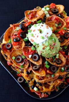 Trashcan Frito Nachos have layers of meat, cheese, fritos and ALL the toppings in every bite!