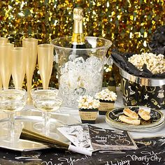 #New Years Eve Decorating Idea.  Popcorn  fills the Party hats, sparkling champagne and lots of treats makes a great display!
