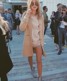 Nude pea coat, light nude long sleeve sweater, dark nude or grey skirt, and grey boots