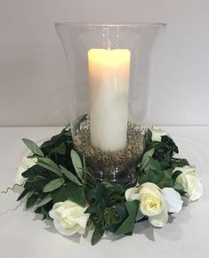 Hurricane vase centrepiece with large pillar candle and ivory rose garland trim #piecesandposies