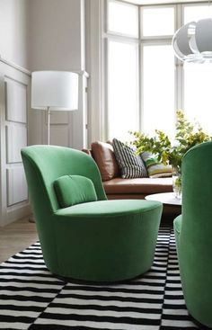 One way to incorporate a bold color into your decor without having it overwhelm the space is with smaller accent pieces like this STOCKHOLM swivel chair in green.