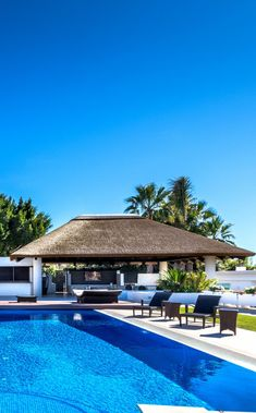 A view like this deserves to be thoroughly enjoyed. A genuine Cape Reed thatched gazebo will provide plenty of shade and shelter to take in all of the natural beauty on display. Outdoor Gazebos, Outdoor Decor, Outdoor Living Areas, Living Spaces, Concrete Column, Gazebo Ideas, Luxury Pools, Pool Bar, Thatched Roof
