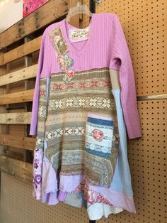 Tattered Gypsy Patchwork Boho Chic Cottage Style Upcycled Sweater Dress Romantic Roses flowers and Lace Embellishments . County Farm Girl Style All Cotton and Ramie Knits Soft Pastel Color palette Lavender Pinks Baby Blue and Tans Very comfortable Roomy and adorable to wear with leggings or jeans and boots.   Size large to XL  Measured laying flat ~  22 across armpit to armpit 33-38 long Free waist and hips