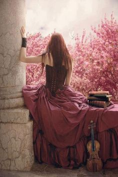 Fantasy Fiction - this pic has everything!  romantic setting, corset, column, wrist warmer, long hair, bare shoulders, pretty pink trees, musical instrument, and a stack of books!!!