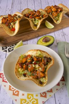 Chicken tostada salad in baked tortilla cups. Recipe by Janette @Culinary Ginger
