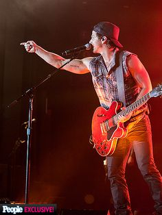 PHOTOS: Backstage with Three of Country's Hottest Guys | GUITAR HERO | Let 'er rip! Moore gets the audience riled up during his featured set. Previous CMT on Tour headliners have included now-superstars Miranda Lambert, Luke Bryan and Jake Owen.