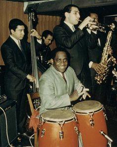 L to R: Victor Venegas/bass, a partially hidden Carmelo Garcia/timbales, Mongo Santamaria/congas, Marty Sheller/trumpet and a partially hidden Hubert Laws/tenor sax.