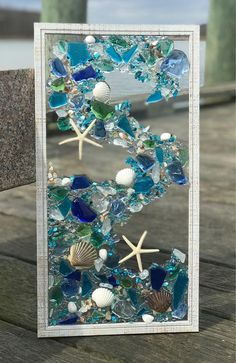 This is a handmade, one of a kind, mosaic coastal window made of sea glass/beach glass art piece. The picture frame measures 21x 11 . There is no glue used in this piece, sea glass, starfish and shells are secured with a resin casting. The frame is equipped for hanging in portrait or #summerResinPatioFurniture