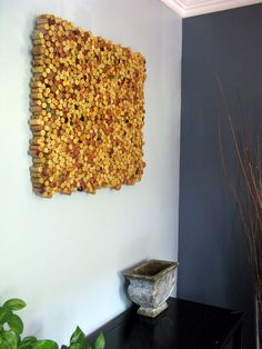 Turn leftover wine corks into wall art.