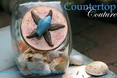 http://www.etsy.com/listing/81370063/blue-shell-and-starfish-jar-by $48