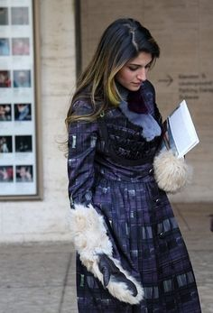 The purple coat and fur sleeves.