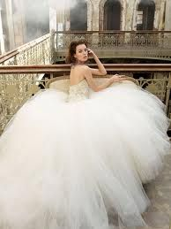 I absolutely love giant ballgown  tulle dresses. This would be my dream wedding dress