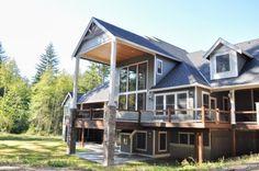 Choice Construction, Remodel, Custom Homes, Gig Harbor, House Exterior, Backyard, Deck, Landscaping, Wood Beams, Stone Columns, Daylight Basement