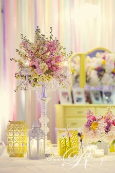 crystal candelabra with soft yellow and pink stock make a lovely centrepiece