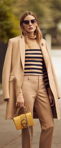 Who made  Olivia Palermo's tan coat, black stripe turtleneck sweater, yellow handbag, and pants?Jacket, sweater, pants, and purse – Banana Republic