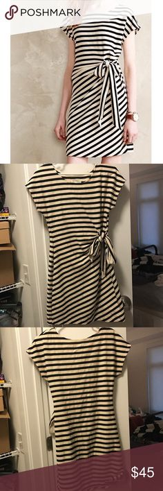 """Anthropologie, Saturday Sunday Isabel Dress Black and white striped dress with tie detail on left front side. 90% cotton, 10% polyester. Approximate measurements: bust 34"""", length 33"""". Excellent condition. Anthropologie Dresses"""