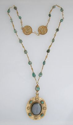 Necklace Date: 6th–8th century Medium: Gold, emeralds & agate intaglio Dimensions: Overall: 15 11/16 x 1 7/8 x 3/16 in. (39.8 x 4.8 x 0.5 cm) Pendant: 2 1/2 x 1 7/8 x 3/16 in. (6.3 x 4.8 x 0.5 cm) Agate intaglio: 1 1/4 x 1 1/16 x 3/16 in. (3.2 x 2.7 x 0.5 cm) Chain: 23 3/4 x 13/16 x 3/16 in. (60.4 x 2.1 x 0.5 cm) Classification: Metalwork-Gold Credit Line: Purchase, funds from various donors, 1958 Accession Number: 58.43