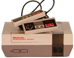 Nintendo NES console with controllers. I want one soo bad!!