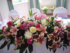 #Wedding reception #bridal #table #flowers top table lily pink