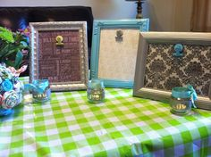 Frame scrapbook paper or fabric, spray decorative frame to go with it and adhere paperclip to glass to hold photo.