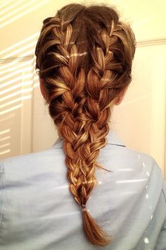 Looks more complicated than it is--just make two french braid and bobby pin them together at the bottom. Viola!