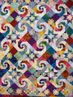 Rising Star and Snail's Trail combined on a brightly colored quilt